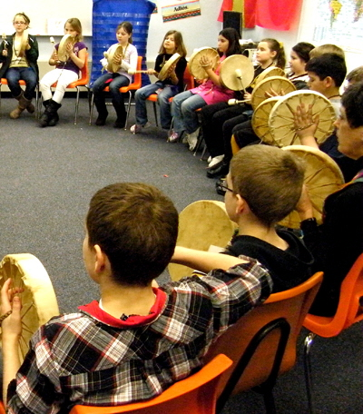 4th graders take part in drum circle with their new Native American drums.