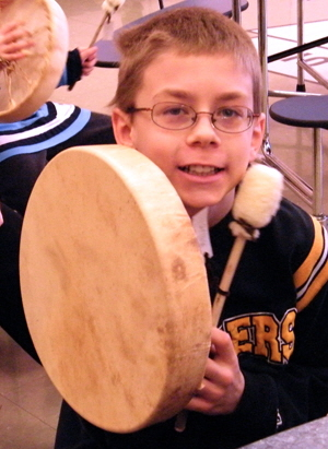 4th grader shows off his finished drum.
