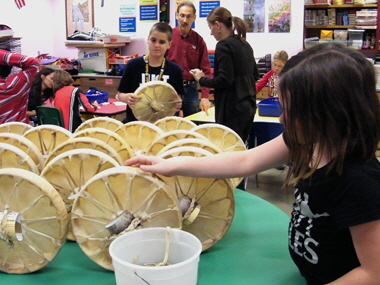 Students place finished drums together to begin drying.